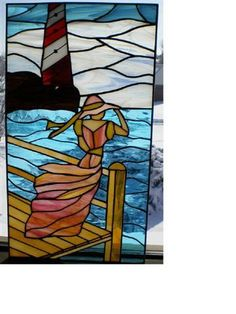 Lady #3  Freehand design set in stained glass. Woman in flowing dress overlooking ocean with lighthouse in background