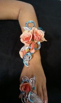 Art corsages are custom designed and hand made only at Rockledge Roses & Wines. They are beautiful pieces of jewelry with fresh flowers attached. Corsages, rings, necklaces, and head pieces in virtually any color combination with or without bling. www.rockledgerosesandwines.com