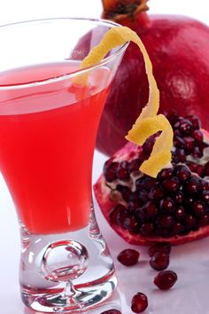 Pomegranate Martini - 1 1/4 cup fresh pomegranate juice, 2 oz. Absolute Citron Vodka,1 oz. Cointreau,   Splash of sparkling water, Squeeze of lemon, Pomegranate seeds, for garnishing--Fill a cocktail shaker halfway with ice.  Add ingredients, shake, and strain into martini glass.  Garnish with pomegranate seeds.