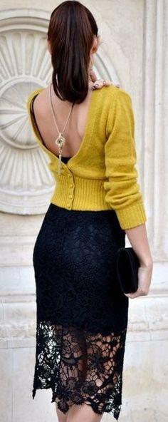 The sweater looks like it was put on backwards, but I like the dress underneath