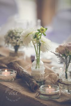 Simple but beautiful flowers in Rustic style Jars & Bottles with Hessian & Bark.....created by Wedding & Events Floral Design www.weddingandevents.co.uk