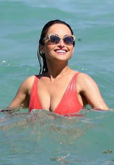 Giada de Laurentiis, looks toned in a plunging red swimsuit as she splashes around in Miami Food Network Star, Food Network Recipes, Giada At Home, Everyday Italian, Giada De Laurentiis, Red Swimsuit, Stay In Shape, Miami Beach, Movie Stars