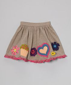 Nearly as precious as the little lady in it, this darling skirt is crafted from a soft cotton blend with vibrant, homespun appliqués that make it playful as well as pretty. An elastic waistband adds extra comfort.