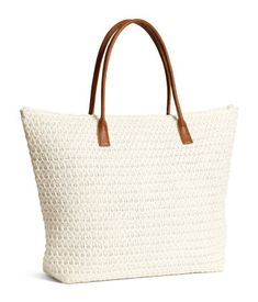 Soft straw bag with double handles in imitation leather and top zip. Two inner compartments. Lined. Size 13 3/4 x 19 1/4 in.