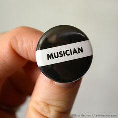 Wear it proudly. Black and white button measures 1 inch in diameter, approximately the size of a US quarter. Packaged carefully in a clear cello sleeve and shipped in a sturdy mailer. Makes a great sm