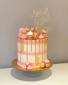 A stunning striped pink and white buttercream drip cake with perfectly piped buttercream swirls and handmade macarons in gold! Complete with a glittering topper, the perfect addition to any special occasion. 16th Birthday Cake For Girls, 19th Birthday Cakes, Birthday Drip Cake, Sweet 16 Birthday Cake, Beautiful Birthday Cakes, Adult Birthday Cakes, Birthday Cake Decorating, 13th Birthday, 30th Cake