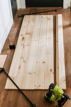 DIY barn door plans and tutorial. We snuck a little something on the back side of this door you have to see! Diy Barn Door Plans, Diy Sliding Barn Door, Diy Door, Sliding Doors, Diy Wood Projects, Home Projects, Barn Door Handles, Diy Barn Door Hardware, Barn Door Designs