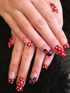 Minnie Mouse Disney freehand nail art with red and white polka dots, Mickey Mouse ears and 3D acrylic nail art on acrylic nails