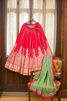 Classic red sabyasachi bridal lehenga , red bridal lehenga green apple dupatta