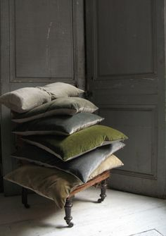 Beautiful large velvet cushions in muted colours look great piled on the bed for a sumptuous and relaxed feel.