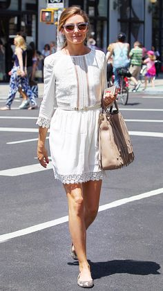 Olivia Palermo in a white lace dress and flats