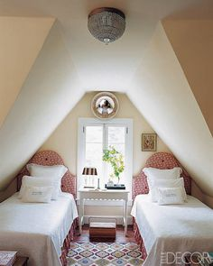 A pair of arched headboards flank a casement window  - ELLE DECOR
