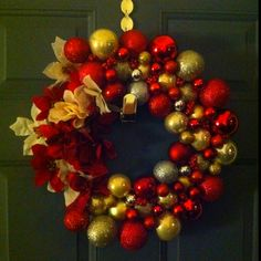 I just made this wreath out of ornaments and poinsettia flowers!
