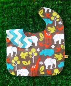 Oversized No Mess Reversible Bib in Zoology Warm / Chevron Aqua. Wear it on your tot during feeding time. The oversized bib protects your child's clothing... No need to worry about spills, stains and mess! Best especially for moms who are scared of getting their child's clothes dirty! =)  Send us a message at info@ilovebabinski.com & LIKE us on Facebook  Php 120.00 www.ilovebabinski.com