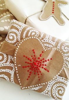 Wrapping paper, beautifully painted and not difficult. Gingerbread Man labels and heart wrapping paper. How fun is this?