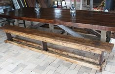 Our 12' Barn Trestle Table we built from old barn rafters.  The benches are 10' long and the table seats 14