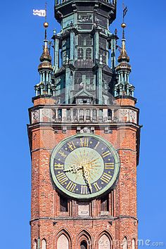 Historical clock on the tower of the Town Hall in Gdansk, Poland.