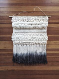 This is a hand woven wall hanging in a palette of creamy neutrals. The ends of the fringe are dip-dyed grey. The dowel is 24 inches wide, and the Weaving Wall Hanging, Weaving Art, Tapestry Weaving, Loom Weaving, Wall Tapestry, Hand Weaving, Weaving Projects, Diy Craft Projects, Strands