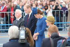 The Duke and Duchess bow their heads after laying a wreath at the Cenotaph