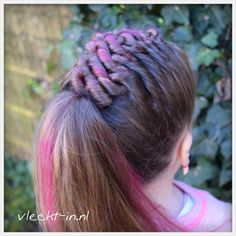 A zig zag twist braid with hair chalk.