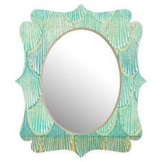 """Designed by artist Cori Dantini, this chic wall mirror pairs its quatrefoil silhouette with an ombre-inspired scales motif.     Product: Wall mirrorConstruction Material: Engineered wood, mirrored glass and aluminumColor: TurquoiseFeatures:  Designed by Cori Dantini for DENY DesignsGlossy aluminum face Dimensions: Small: 19.5"""" H x 14.5"""" WMedium: 29.2"""" H x 21.7"""" WLarge: 36"""" H x 30.6"""" WCleaning and Care: Spot clean with window cleaner"""