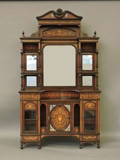 An inlaid Victorian rosewood mirror back sideboard. Sold for £480.