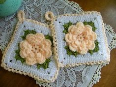 This is a lovely set of rose motif potholders, both functional and a very pretty wall decor for the kitchen.    Hand-crocheted in white, peach and gre