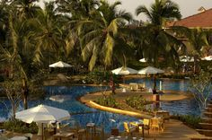 The Ramada Caravela beach resort in Goa is a beautifully landscaped, 25-acre #resort hugging Goa's most popular beach, Varca. This Five Star Deluxe #hotel in #Goa with its white stucco walls, high ceilings, arches and gabled roofs. #vacation #destination #wanderlust