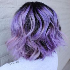 wavy pastel purple bob with black roots