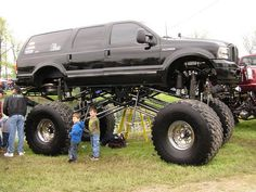 Those kids make this Ford Excursion look like a skyscraper.