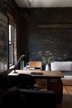 .Black walls......tan desk