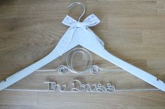 Personalised Disney style wedding dress hanger with lace bow and blue Annie Sloan paint. Cinderellas carriage in wire, bride / hen do gift