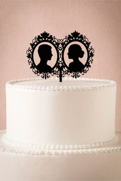 Silhouette Cake Topper from BHLDN - I could easily make this myself with some acrylic & a laser cutter :)