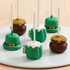 St. Patrick's Day Brownie Pops - This exclusive gift from @sharisberries celebrates some of our favorite St. Patrick's Day symbols: pots of gold, pints of ale and leprechaun hats! Each hand-decorated, fudgy brownie pop is individually wrapped, making them the perfect treats for sharing on St. Patty's.