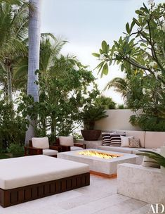 Travertine from central Mexico anchors George Clooney's outdoor living area and fire pit in his Mexican villa by Legoretta + Legoretta | archdigest.com