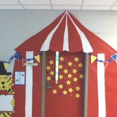 """Presenting, the greatest students on Earth! Circus tent I created for my classroom. Carried the theme into the room by hanging a large parachute from the ceiling to create a ""big top"" feel."