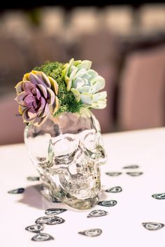 The #pretty #succulents in #striking #clear #crystal #skeletonvases, with their #trademark #styled #stamp on the #tables as #centerpieces. ::Tessa + Ryan's awesome event of a wedding in Romare Bearden Park and the Fillmore in Charlotte, North Carolina:: #purple #green #skeleton #skeletonweddings #weddingthemes #modernwedding #weddingphotography