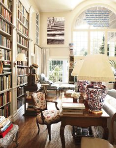 """From the front door, I could immediately see right into the living room and out that big, beautiful window, all the way to the backyard,"" Moss says. ""I thought it was the antidote to city living. City Living, Living Spaces, Living Room, Beautiful Interiors, Beautiful Homes, Beautiful Library, Dream Library, Grand Library, Design Minimalista"