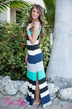 Take this new maxi to the beach or wear around town for a beachy feel! It features black, white, grey, teal, and navy stripes, a scoopneck, and a slit on one side! Add wedges or sandals for a complete look!