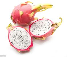 The luminous pink casing of the dragon fruit hides speckled white and black…