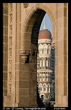 Taj Mahal Palace Hotel seen through arch of Gateway of India. Mumbai, Maharashtra, India