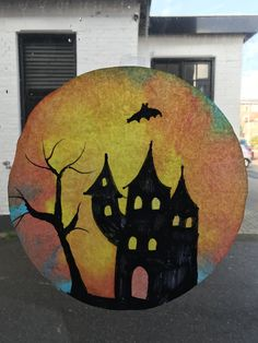 Halloween haunted house. spookhuis op koffiefilter. raamdecoratie.