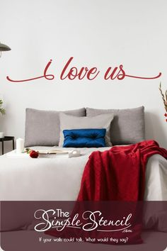 "This contains: This picture shows a beautifully scripted vinyl wall decal that reads ""i love us"" in the color Merlot sized to go behind the entire bed in a large 72"" x 12"" size. Shown on a beautifully decorated master bedroom wall in a color to compliment the other elements in the room. Family Room Walls, Dining Room Walls, Vinyl Wall Quotes, Vinyl Wall Decals, Bedroom Wall, Bedroom Decor, Romantic Master Bedroom, Design Your Bedroom, Wedding Wall Decorations"