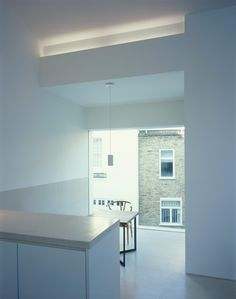 New Mews House | Jonathan Tuckey Design, West London, UK - The kitchen is finished in a tiled terrazzo flooring, cast terrazzo worktop, and wall lining.