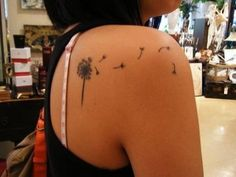 Every floating seed in this tattoo is meant to represent another loss. So sad ... but beautiful!