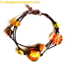 RobyGiup Handmade: Bracciale in cuoio e perle di vetro e acrilico gialle - Bracelet in leather with glass and acrilyc yellow beads