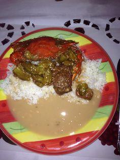 Durie blanc sauce pois blanc calalou avec crab mmmmmm sooooo good Haitian food ( white rice white bean smash with okra gravy )