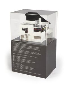 A SCALE 1:20 MAQUETTE OF THE INTERIOR OF THE FIRST FLOOR OF THE RIETVELD SCHRÖDER HOUSE BY WERKPLAATS VOOR ARCHITECTUUR UTRECHT AND BERTUS MULDER, CIRCA 1974 Constructed from wood, plastic and paper, mounted on a rectangular wooden base lined with a label inscribed rietveld schröder huis interieur verdieping schaal 1:20 werkplaats voor architectuur utrecht and with a perspex cover, supported by a loose socle inscribed with entry information for the Rietveld Schröder house