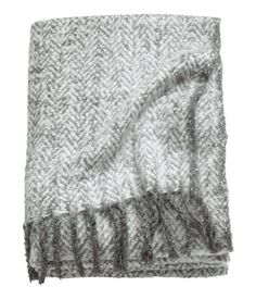 Gray. Throw in soft, jacquard-weave bouclé fabric with a herringbone pattern. Fringe on short sides.