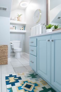 Kids' Bathroom remodel with pops of light turquoise, yellow, and green – All Things Thrifty